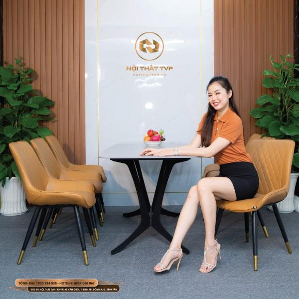 Bộ bàn ăn 6 ghế mặt gốm Ceramic trắng, chân cánh bướm, ghế Loft trám bọc da Microfiber chống cháy, chân inox mạ titan - cam