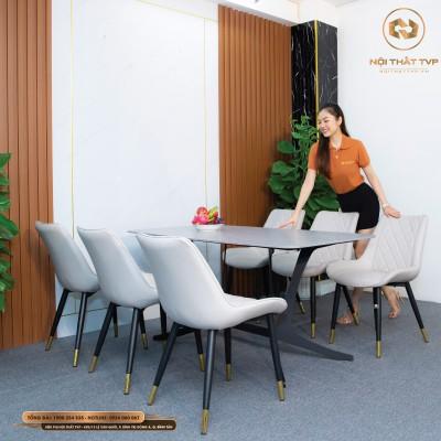 Bộ bàn ăn mặt gốm Ceramic xám, chân cánh bướm, 6 ghế Loft trám bọc da Microfiber chống cháy màu đen